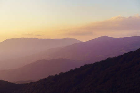 Mountain landscape in sunrise or sunset - Foggy image of hills covered with forest and sky - freedom nature tourist destination concept - stara planina Old Mountain in Serbia Stock Photo