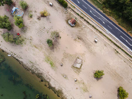 Top down aerial view on the sand beach by Danube river at Brza Palanka town destination with main road beside in summer day - freedom nature travel concept with copy space Stock Photo - 153257816