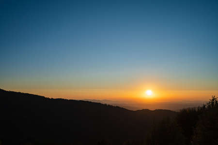 Mountain landscape in sunrise or sunset dark hills with golden sun and blue sky - freedom nature tourist destination concept - stara planina Old Mountain in Serbia Stock Photo - 155600372