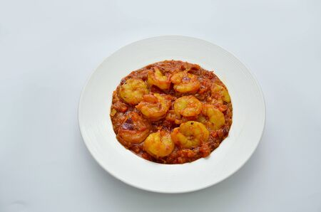 professional photography of shrimp fry masala curry with white background