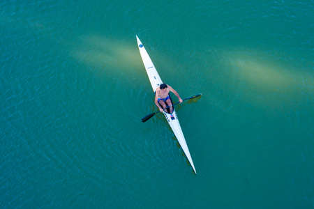 Valladolid, Spain - 23 July 2020: Peoples enjoying a ride in kayak during summer vacation,Top view Valladolid Spain