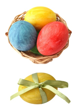 Painted Easter eggs in basket on white background photo