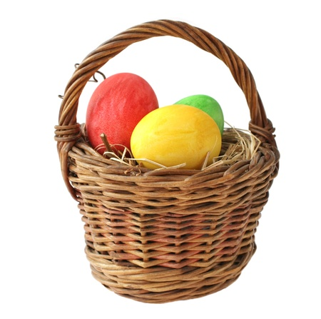 Painted Easter eggs in basket on white background Stock Photo - 12850074