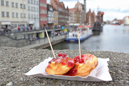 oscypek: Sheep fried cheese with cranberry sauce. Street food on the embankment in Gdansk. Polish cuisine.