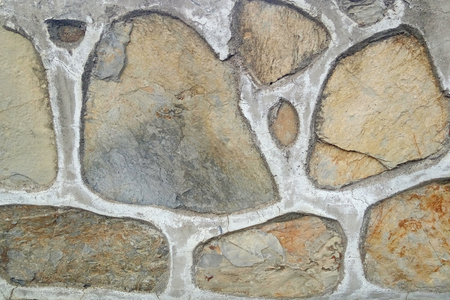 Old stone wall. Rough stones of different shapes. Stone background. Banco de Imagens