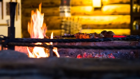 grill: delicious meat roasted on the fire in the cozy restaurant