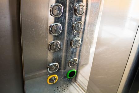 key hole shape: A lot of buttons inside an elevator illuminated