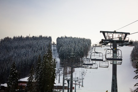 ski runs: Facing the ski runs and ski lift in the snow in the Carpathian mountains