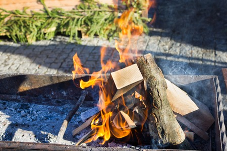 outdoor fireplace: Burning wood for the barbecue at the Christmas Fair