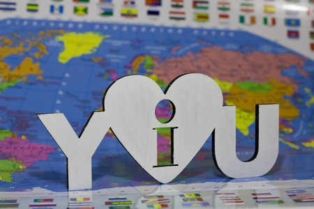 fraternity: inscription on a white stencil I love you on a background map of the earth Earth Day and Valentines Day