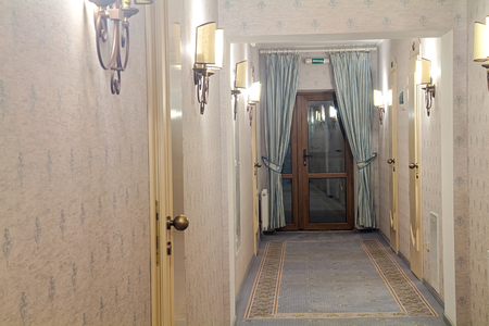 blue carpet: Corridor in the hotel in the evening with a variety of lamps and blue carpet