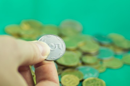 bani: Lots of coins of different values on a green background Stock Photo