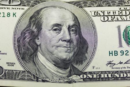 ben franklin money: One hundred dollars close up as background
