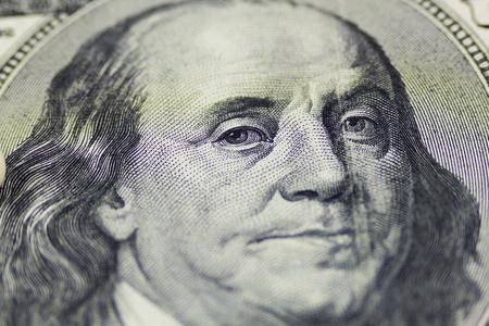 ben franklin money: Macro close up of Ben Franklins face on the US 100 dollar bill.