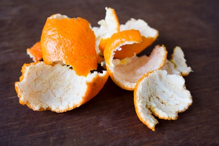 favoring: The peel of citrus lies on a wooden table Stock Photo