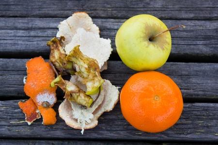 putrid: Fresh fruits orange and apple near putrid
