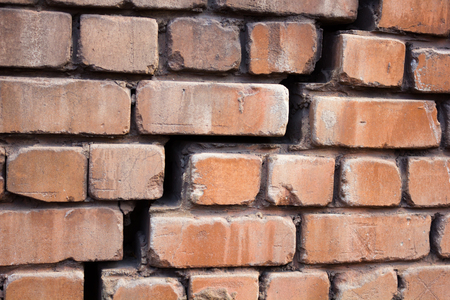 foundation cracks: Large and wide crack in the wall of red brick Stock Photo