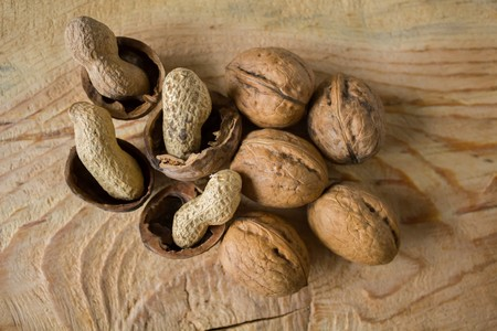 acorn seed: Walnuts and peanuts peel on a vintage wooden background
