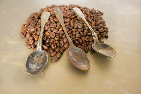 attar: Vintage old rusty spoon and black coffee beans