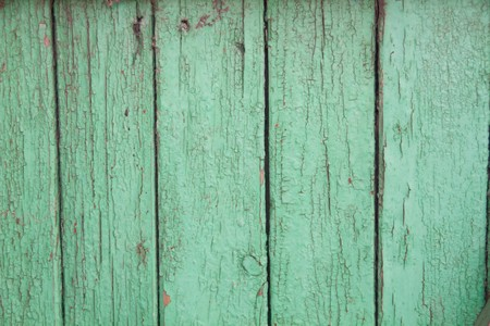 building color: Green peeling paint on an old wooden background texture