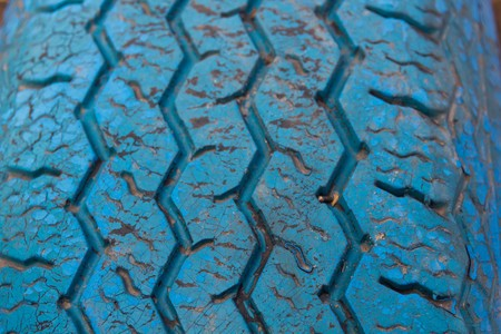 utilized: Texture tire painted blue as a background Stock Photo
