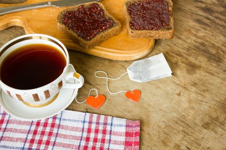 strawberry jam sandwich: light breakfast or lunch , Raspberry jam slices of black bread Vintage cup of tea and teapot