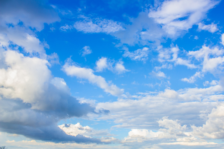 subtlety: blue sky with white clouds of different shapes in perspective Stock Photo