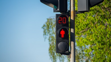 trafficlight: Stop sign at the traffic lights on the street