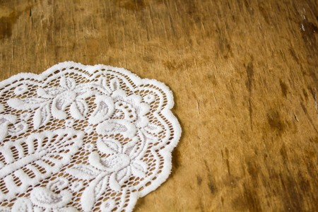 white napkin: Beautiful vintage tracery white napkin on a wooden table