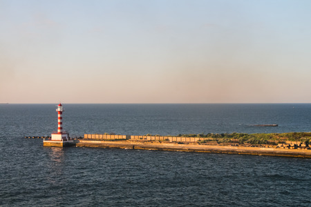 capo: Lighthouse standing in the sea near the port in the sea Stock Photo