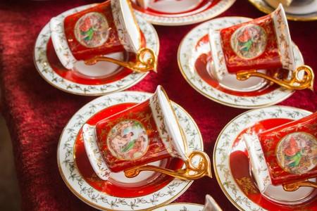 Red vintage tea set at a flea market