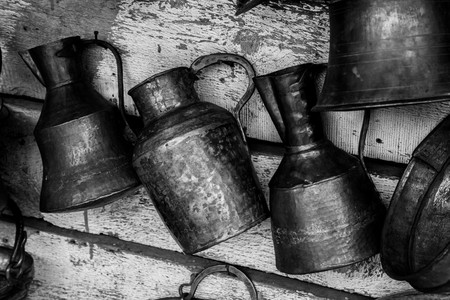 Large old antique copper cans hanging on the wall Reklamní fotografie