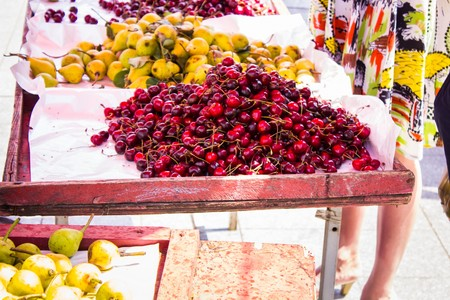 Cherry pear and other summer fruits on a market stall
