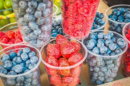 fresh blueberries, currants, blackberries, cranberries and raspberries. Focus berries in spoon Reklamní fotografie