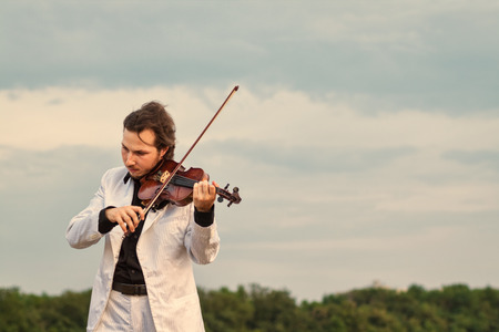 Violinist playing the violin outdoors