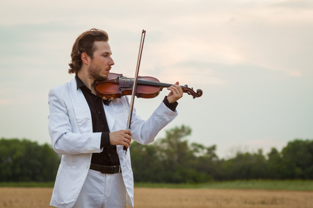 violinist: Professional violinist playing Stock Photo