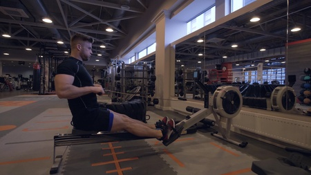 Young man training in fitness club. Fitness and sport lifestyle concept
