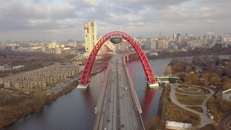 Car moving on Picturesque bridge over Moscow river aerial view