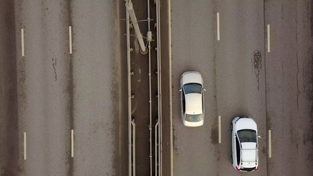 Car traffic on Picturesque bridge over Moscow river on background city landscape