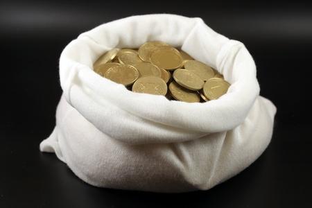 jack pot: Una bolsa con dinero contra el fondo negro