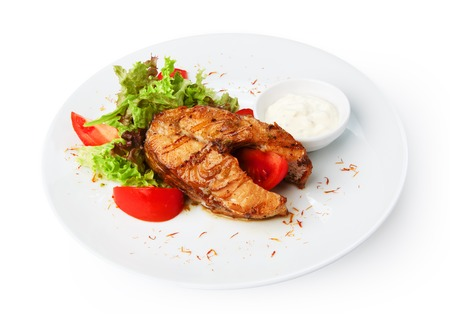 pikeperch: Restaurant food - pikeperch fish steak isolated at the white background
