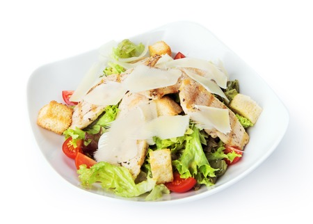 chicken caesar salad: Restaurant food - chicken caesar salad isolated at the white background