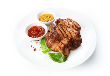 cater: Restaurant food - grilled pork chops with sauces isolated at the white background