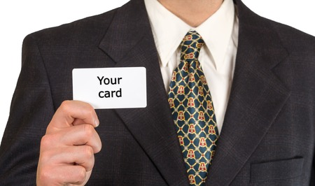 Mans hand is showing blank business card. He is in black suit, white shirt and tie. photo
