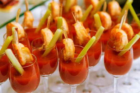 shrimp: Catering - snack coctails with tomato juice and shrimps. Closeup