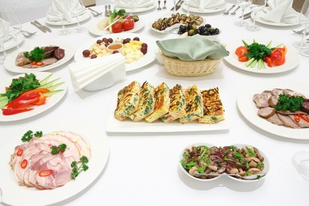 veal sausage: Catering - served table with meat and vegetable cold appetizers Stock Photo