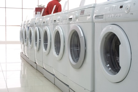 Rows of modern washing machines in a store photo