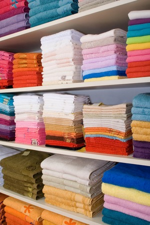 terrycloth: Shelves with colorful towels in the shop