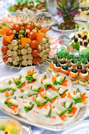 holiday catering: Catering buffet style - tomatoes and olives beautifully decorated on the plate