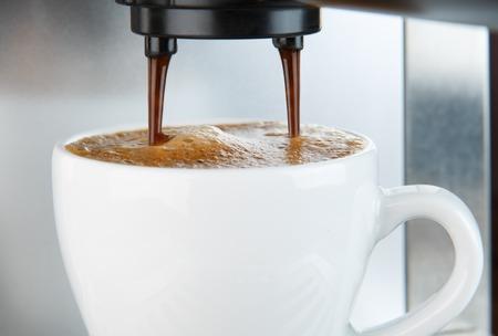 non alcoholic beverage: Coffee machine making espresso coffee close-up
